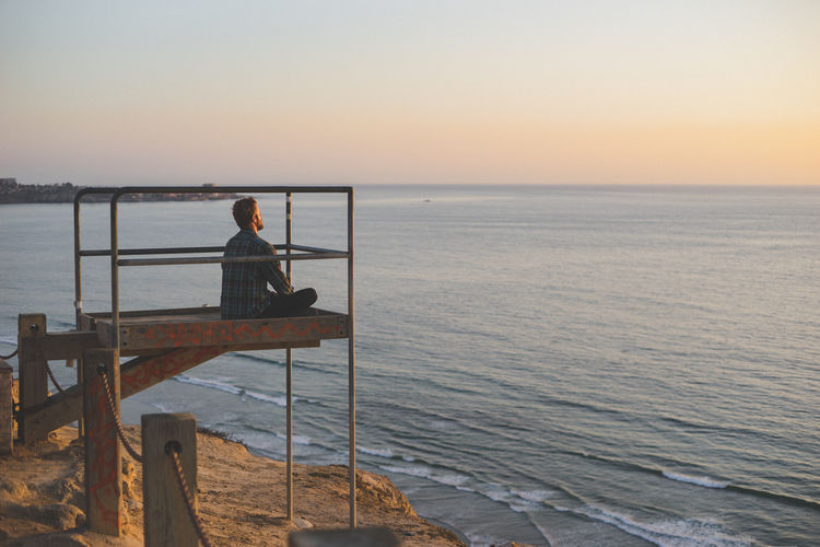 Lost In The Landscape Adult Beauty In Nature Clear Sky Day Fishing Pole Full Length Horizon Over Water Leisure Activity Men Nature One Man Only One Person Outdoors People Real People Scenics Sea Sitting Sky Standing Sunset Tranquil Scene Tranquility Water Weekend Activities