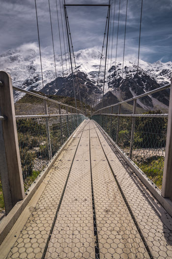 Architecture Bridge - Man Made Structure Built Structure Connection Day Greenhouse Hiking Metal Nature New Zealand No People Outdoors Sky Steel Cable Suspension Bridge The Way Forward Tree