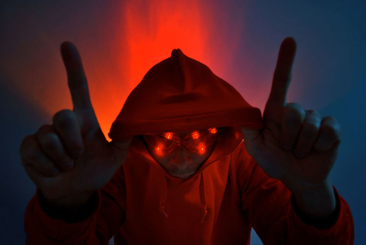 Man Wearing Illuminated Eyewear And Red Hooded Shirt