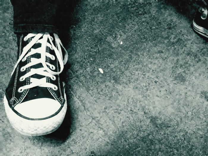 Converse Shoe High Angle View Canvas Shoe Close-up Outdoors Day Human Leg One Person Blackwhite Blacknwhite Blackandwhitephoto Monochrome_life Casual Clothing Casualshoes Awesome Sleek Classic Illuminated Classic Beauty Symbol Prideandjoy