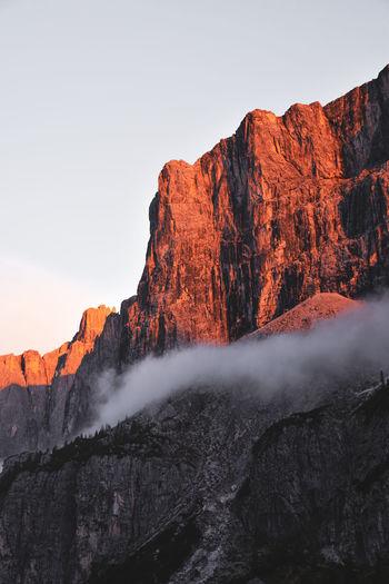 Orange rock formation in sunset light