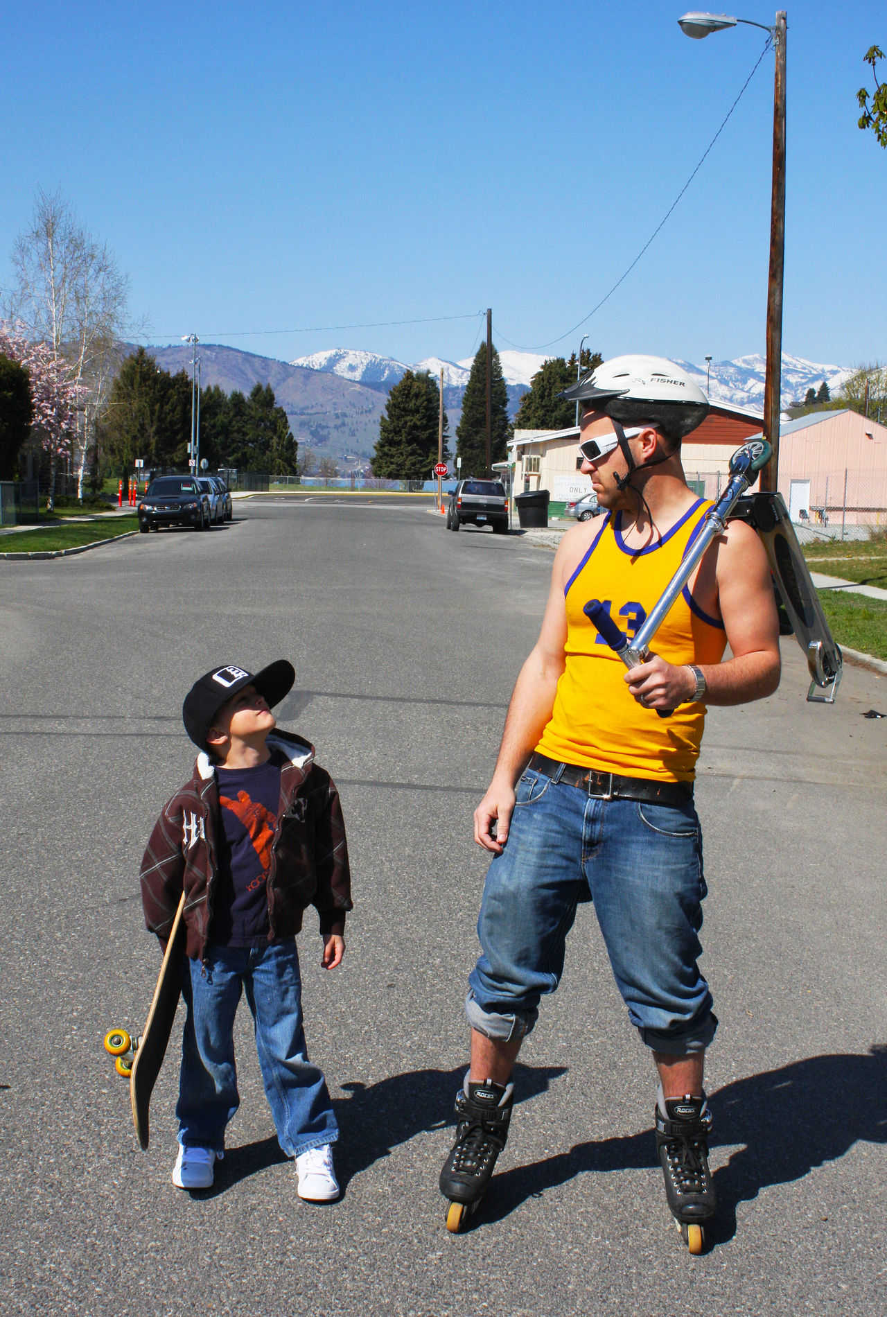 Full length of father and son at street on sunny day