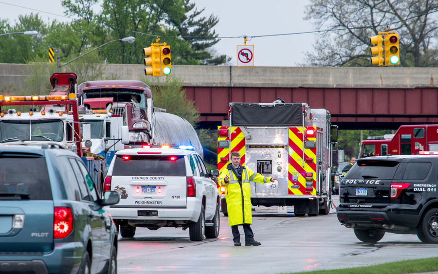 first responders are on hand to direct traffic and help victims at the scene of this accident in Stevensville Michigan on May 18 2018 Fire Engines Security Accident City Clothing Commercial Land Vehicle Day First Responders Full Length Land Vehicle Mode Of Transportation Motor Vehicle Occupation Outdoors People Police Protection Road Safety Security Sign Street Transportation Truck Uniform