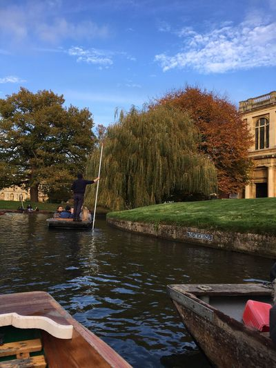 Autumn punting on the River Cam Tree Water Nautical Vessel Outdoors Day Sky Nature River Built Structure Transportation Real People Architecture Moored Building Exterior Grass Beauty In Nature