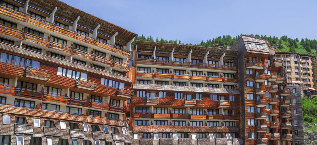Amazing and unusual architecture at Avoriaz, Haute Savoie region, Portes du Soleil touristic place in France. Summer and winter popular resort in Frech Alps mountains. Alps Amazing Architecture Apartment Buildings Architecture Avoriaz Building Building Exterior Built Structure City City Life Day Europe France Haute Savoie Mountain Outdoors Portes Du Soleil Summer Tourism Tourist Attraction  Tourist Destination Tourist Resort Unusual Vacations Wooden