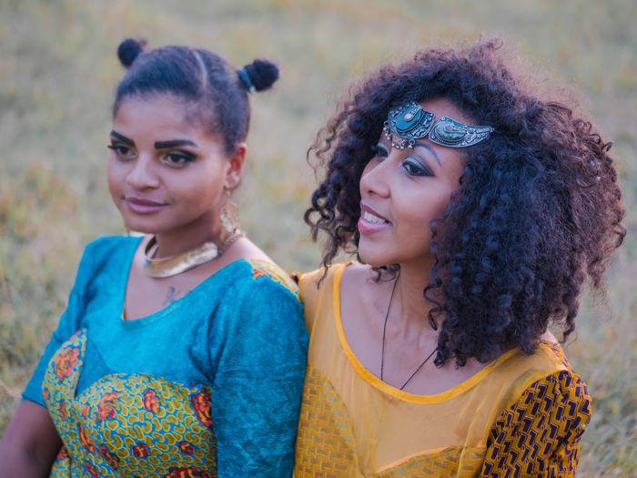 Smiling Female Friends Looking Away