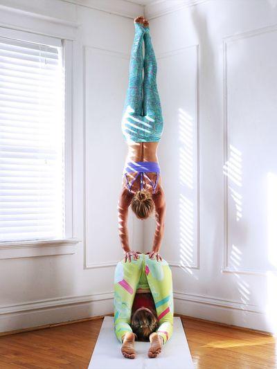 Females Friends Doing Yoga At Studio