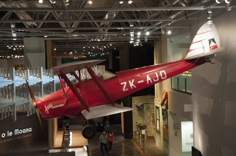 red tiger moth aircraft at an indoor display Tiger Moth Wellington  Architecture Biplane Hanging Illuminated Indoors  Lighting Equipment Red Te Papa
