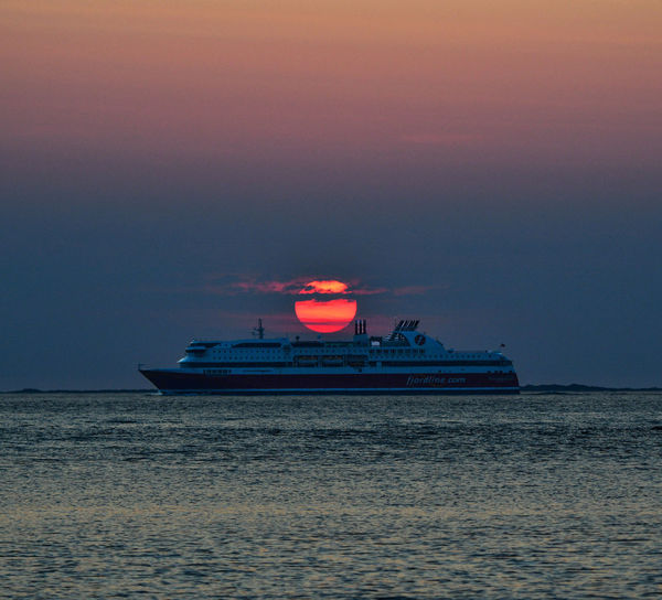 Water Nautical Vessel Transportation Sea Mode Of Transportation Sky Waterfront Sunset No People Scenics - Nature Nature Illuminated Beauty In Nature Outdoors Tranquility Horizon Over Water Horizon Ship Travel Cruise Ship Passenger Craft
