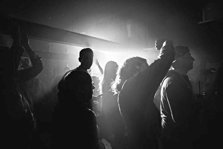 Silhouette of people standing in nightclub