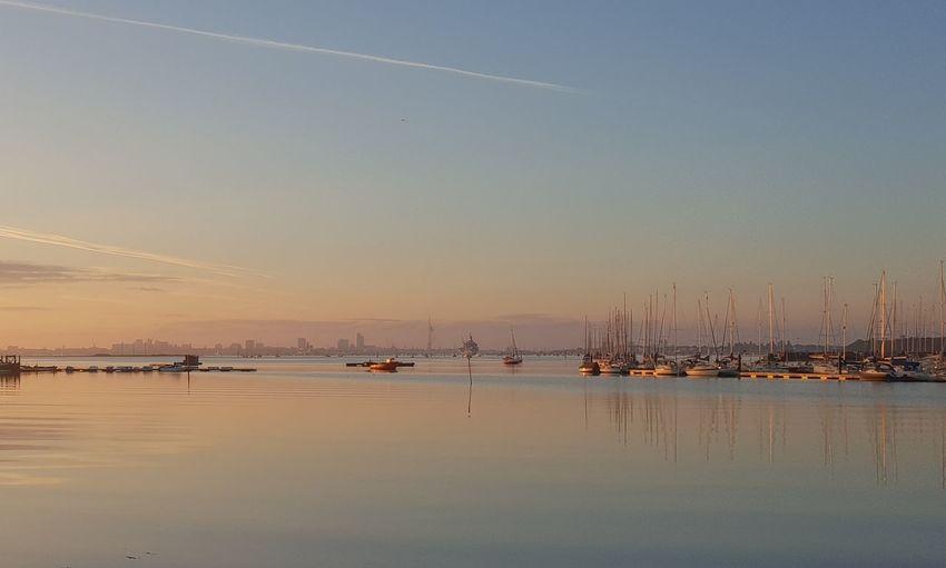 Sailboats In Sea At Sunset