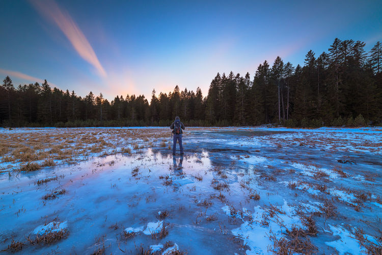 Sunset at Black lake, Pohorje Reflection Slovenia Beauty In Nature Cold Temperature Dusk Frozen Ice Lake Nature Non-urban Scene One Person Plant Scenics - Nature Sky Snow Standing Sunset Tranquil Scene Tranquility Tree Water Winter