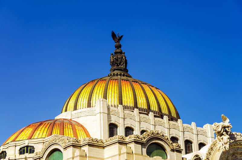 Low angle view of palacio de bellas artes against clear blue sky