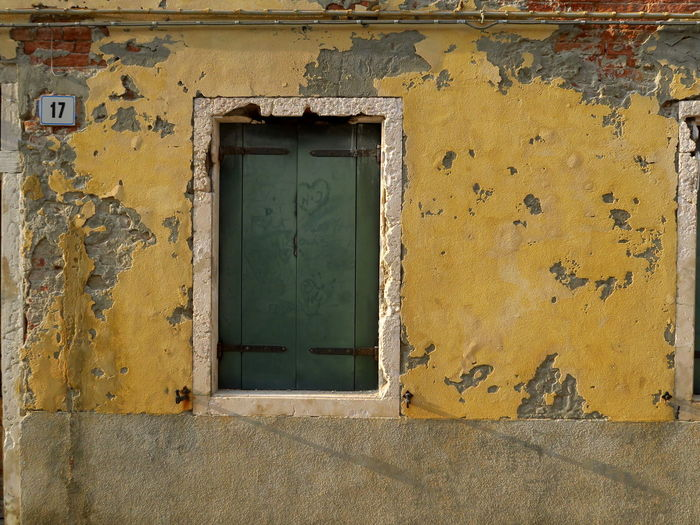 Closed door of house in decay