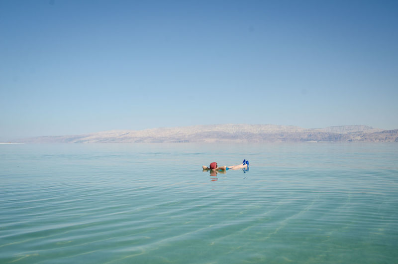 Floating on Water Sea Water Nature Real People Sky Holiday Outdoors Israel Beauty In Nature Dead Sea  Tranquil Scene Leisure Activity Floating On Water Nature Of Being