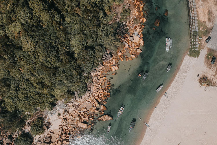 Beach Beauty In Nature Cliff Coastline Day Group Of People High Angle View Incidental People Land Nature Outdoors Plant Rock Rock - Object Sand Scenics - Nature Sea Solid Water