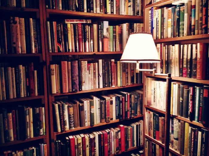 Lamp in front of bookshelf
