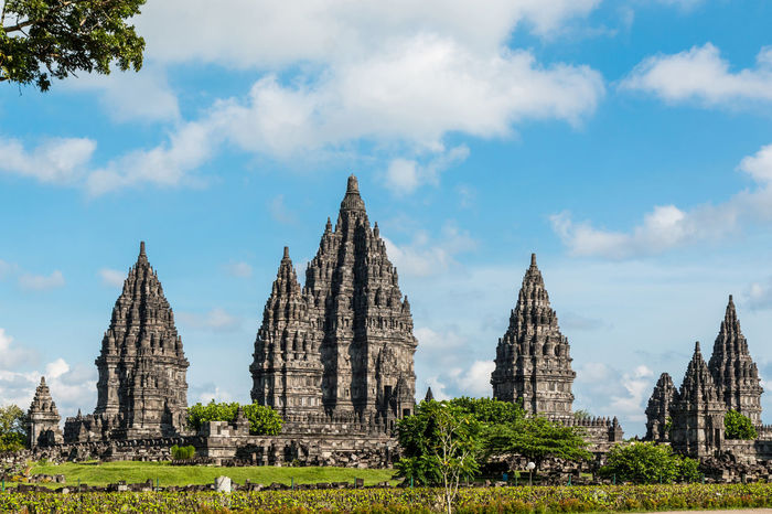 Prambanan temple (Candi Rara Jonggrang) is an hindu temple compound with sunny and cloudy day in Central Java, Indonesia. (Public place) (UNESCO World Heritage Site) Ancient Ancient Civilization Architecture Building Exterior Built Structure Cloud - Sky Day Hindu Hindu Temple Hinduism History Landmark Landscape Outdoors Place Of Worship Prambanan Prambanan Temple Religion Ruins Sky Spirituality The Past Tourism Travel Destinations UNESCO World Heritage Site