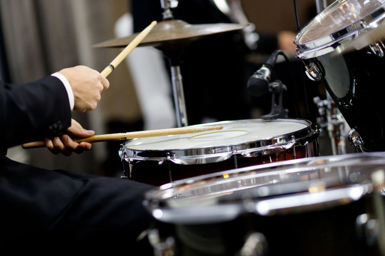Male musician playing drums Music Musical Instrument Drum - Percussion Instrument Musical Equipment Arts Culture And Entertainment Musician Drumstick Drummer Artist Drum Occupation Men Performance Percussion Instrument Holding Real People Indoors  Drum Kit Skill  Focus On Foreground Hitting Stage Professional