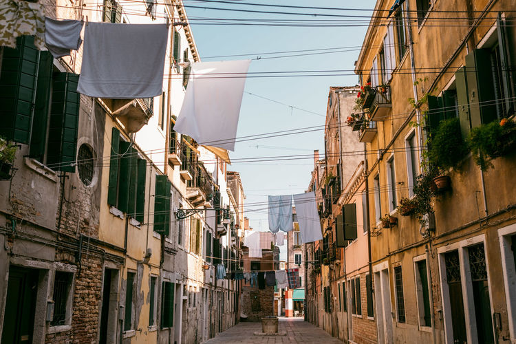 Venice Architecture Built Structure Building Exterior Building Cable Residential District Day The Way Forward Incidental People Outdoors City Direction Low Angle View Sky Nature Window Walking Men Two People Hanging Alley