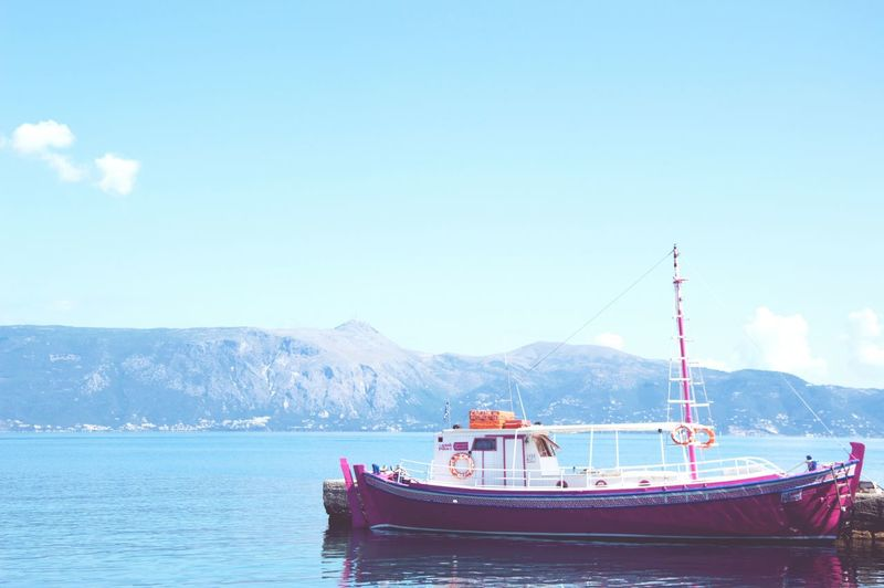 Transportation Blue Water Sky Sea Outdoors No People Day Mountain Nature Tall Ship Pink Ship Shore