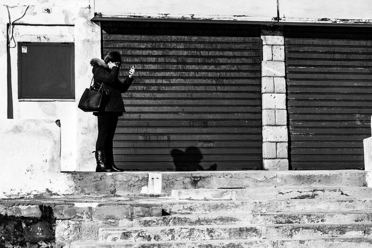 Man and woman against building