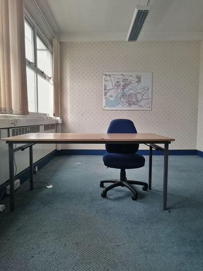 Empty chair with table in office