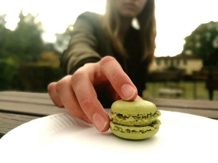 Close-up of hand holding macaroon