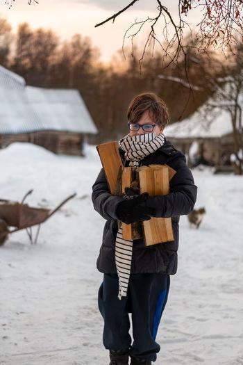 Full length of man standing on snow land