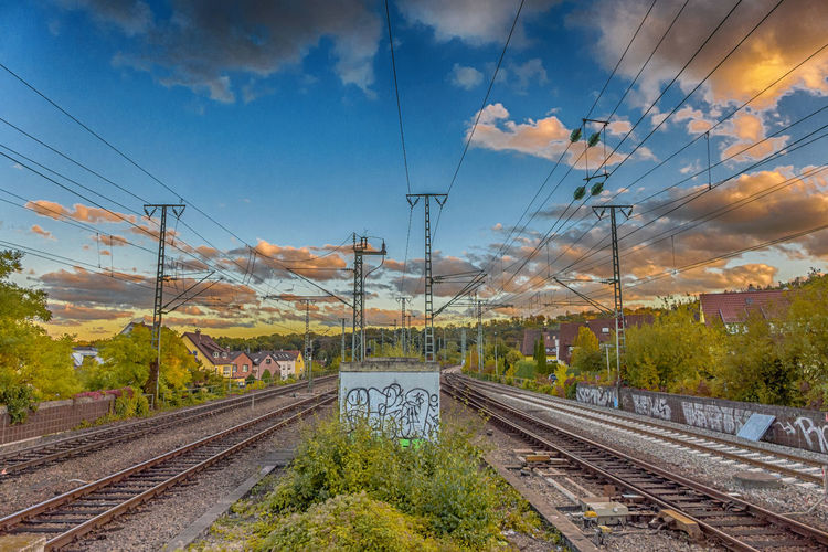railways under a cloudy evening sky HDR Cable Cloud - Sky Complexity Connection Day Electricity  Electricity Pylon Nature No People Outdoors Power Line  Power Supply Public Transportation Rail Transportation Railroad Railroad Tie Railroad Track Railway Signal Railway Track Sky Technology Transportation Travel Tree