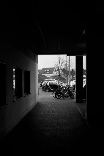 Discipline Car Park Cars Architecture Blackandwhite Building Exterior Built Structure Day Land Vehicle Mode Of Transport Monochrome No People Outdoors Shopping Mall Transportation Tree Windows