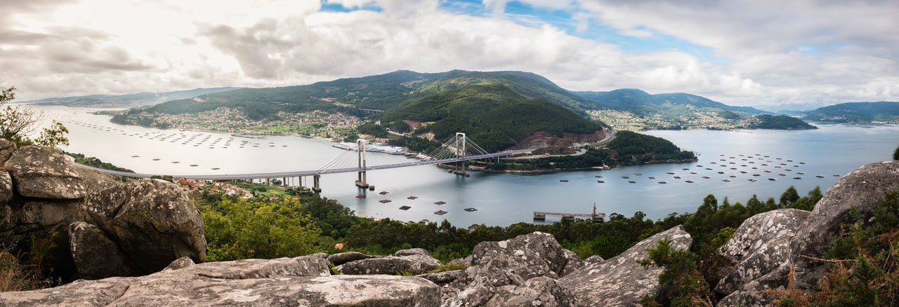Panorama view of the ria de vigo estuary from redondela on a cloudy summer afternoon.