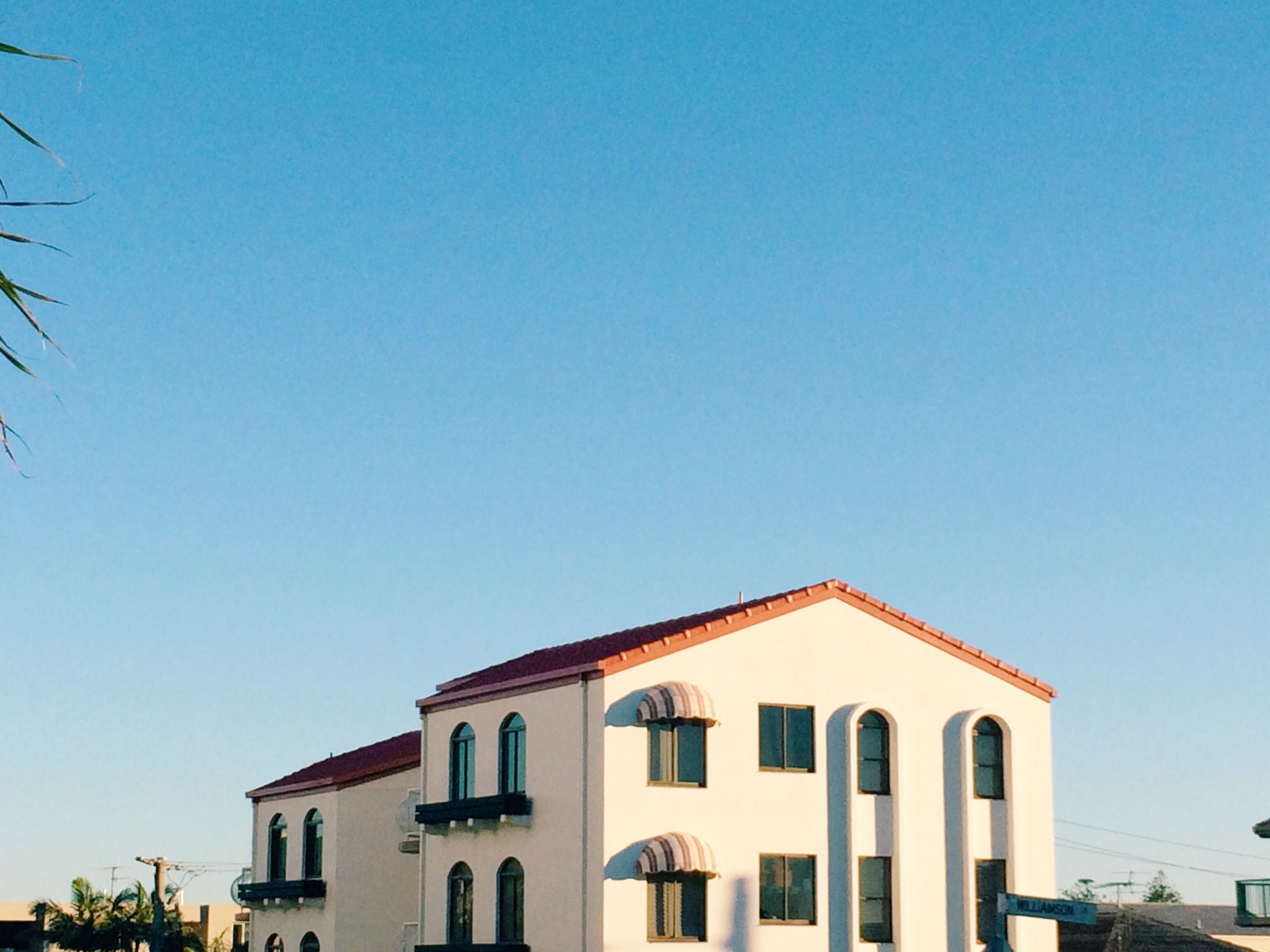 architecture, building exterior, built structure, clear sky, low angle view, blue, residential structure, residential building, building, high section, day, outdoors, no people, exterior, sky