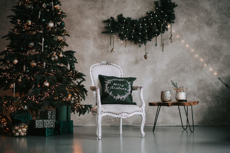 Illuminated christmas tree on table