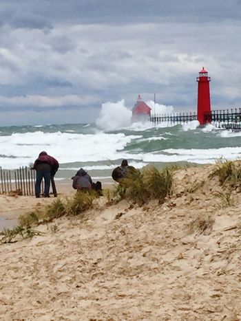 Standing in 53 mile per hour wind gust wasn't easy😳 13 ft. Waves was worth it! Storm Stormy Weather Lake View Lake Michigan Waves Waves Crashing Pier Lighthouse Wind Windy Blowing Sand Dark Clouds People Michigan United States Pure Michigan