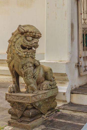 Cute stone of Chinese arts statue in Wat Suthat Temple, Bangkok, Thailand. Wat Suthat Wat Suthat Thepwararam Architecture Art And Craft Belief Building Building Exterior Built Structure Carving - Craft Product Craft Creativity Day Human Representation No People Old Religion Representation Sculpture Spirituality Statue Wall - Building Feature
