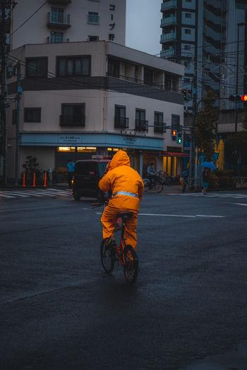 Man riding motorcycle on city street