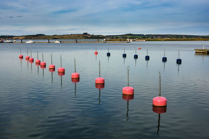 Buoys on the Baltic Sea coast. Baltic Sea Beauty In Nature Buoy Buoy On The Water Buoys Cloud - Sky Coast Day Floating On Water In A Row Lake Nature No People Outdoors Red Reflection Rügen Shore Sky Tranquility Water