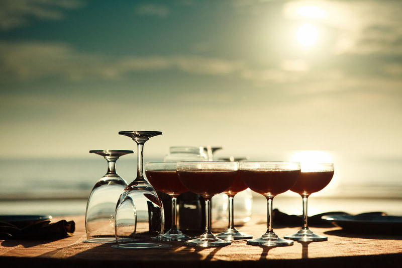 Alcohol Beach Cafe Destination Drink Drinking Glass Food And Drink Glass Holidays Outdoors Punch Refreshment Restaurant Seaside Shiny Still Life Sunset, Table Terrace Thailand Transparent Tropical Vacation Wine Wineglass