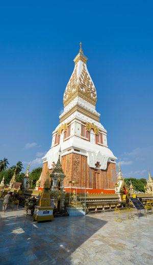 Temple building against clear blue sky