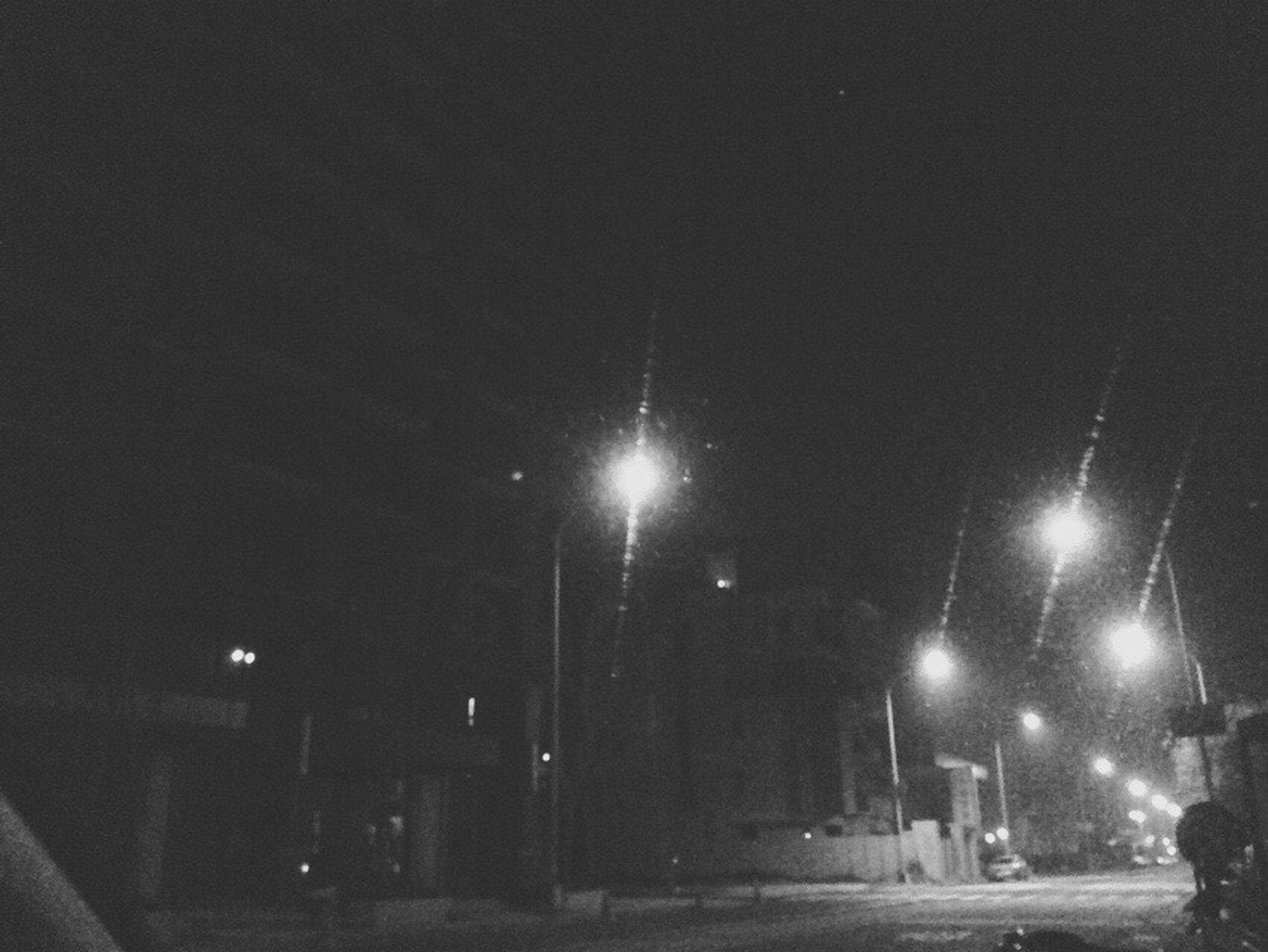 illuminated, night, street light, street, transportation, lighting equipment, building exterior, built structure, architecture, road, city, car, sky, city life, land vehicle, the way forward, mode of transport, incidental people, outdoors, light - natural phenomenon