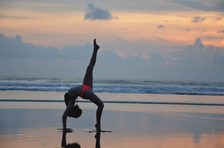 Beach Beach Day Beachtime Bali, Indonesia Bali Island Balance Yoga Practicing Healthy Lifestyle Lifestyles Flexibility Sea Beauty In Nature One Person Sky Concentration Water Nature Women Outdoors Cloud - Sky