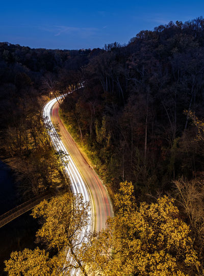 Beauty In Nature Bridge Curve Driving High Angle View Highway Illuminated Light Trail Long Exposure Motion Nature Night No People Outdoors Sky Speed Thoroughfare Traffic Transportation Tree Vehicle Light Winding Road