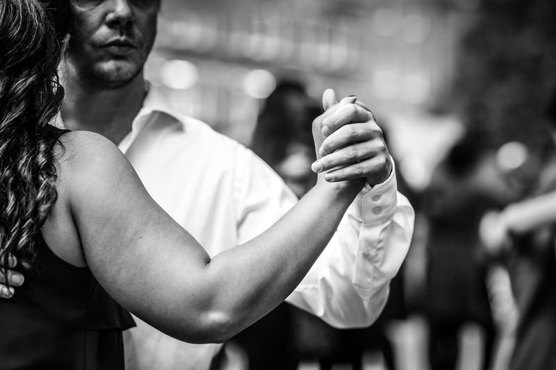Tango at Spitalfields Market Couples Dance Dancing Hand Hands Holding London Pairs Partners Spitalfields Market Street Photography Streetphotography Tango Monochrome Photography Postcode Postcards