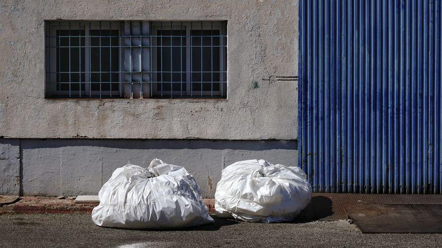 Garbage on street against building