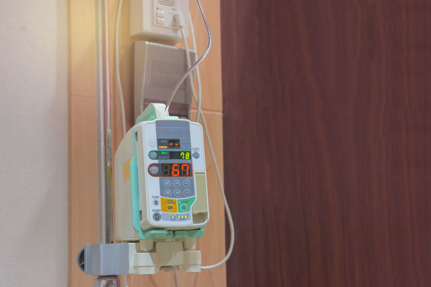Hospital Architecture Built Structure Close-up Communication Connection Control Day Hand Indoors  Infusion Pump No People Number Patient Sign Still Life Technology Telephone Telephone Booth Text Tools Wall Wall - Building Feature Western Script