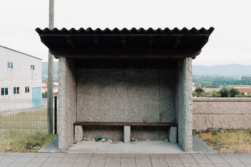 LOST IN GALICIA 🚌 Lostingalicia Threeweeksgalicia Bus Stop Architecture Built Structure Building Exterior Day No People Nature Outdoors Sky Architectural Column Building Plant Tree Footpath Empty Absence Safety Connection Belief Religion Façade Concrete