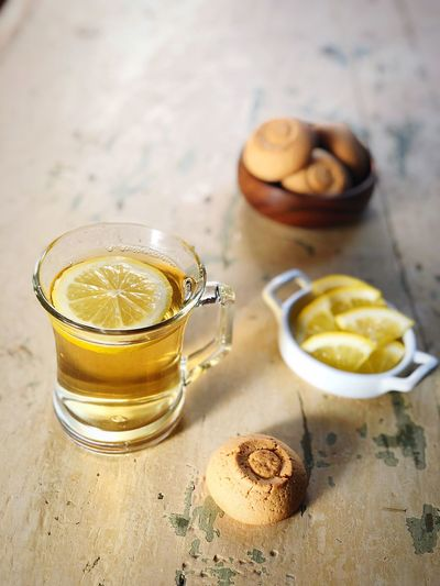 Copy Space Wooden Table Tea Cookies Tea Herbal Tea Food And Drink Food Freshness Drink Refreshment Table Healthy Eating Still Life Glass Wellbeing No People Lemon