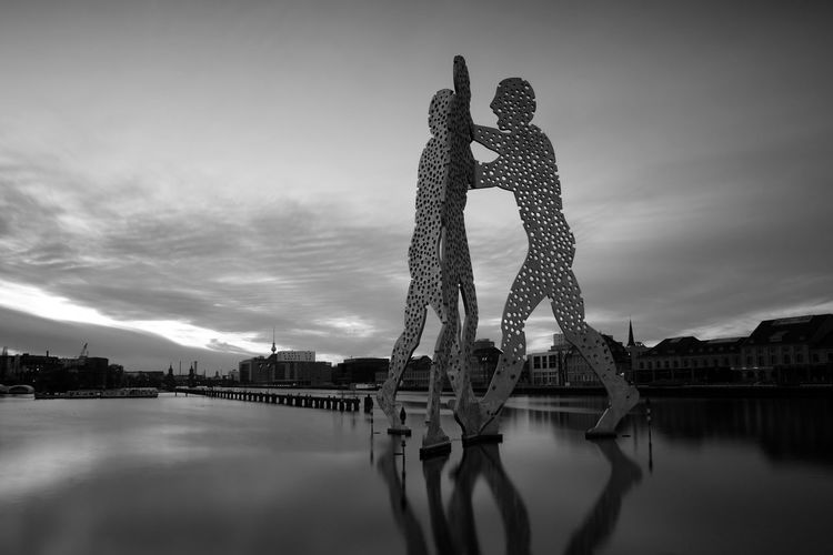 Berlin Molecule Man Berlin Friedrichshain Kreuzberg Molecule Man Spree Architecture Bridge - Man Made Structure Building Exterior Built Structure Cloud - Sky Day Monochrome No People Outdoors Reflection Sky Treptow Water