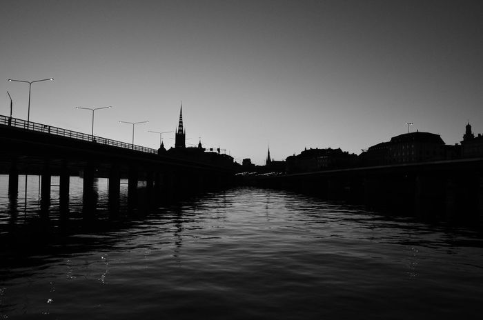 Architecture Bridge Cityscape Evening Light Evening Sky River Riverside Photography Silhouette Spire  Stockholm Sunset Trainline Water Blackandwhite Photography Black And White Photography
